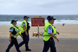 Police officers patrol the almost empty Bondi Beach on Christmas Day in Sydney.