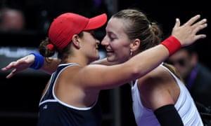 Ashleigh Barty hugs Petra Kvitova at the net after the Australian's straight-sets victory.