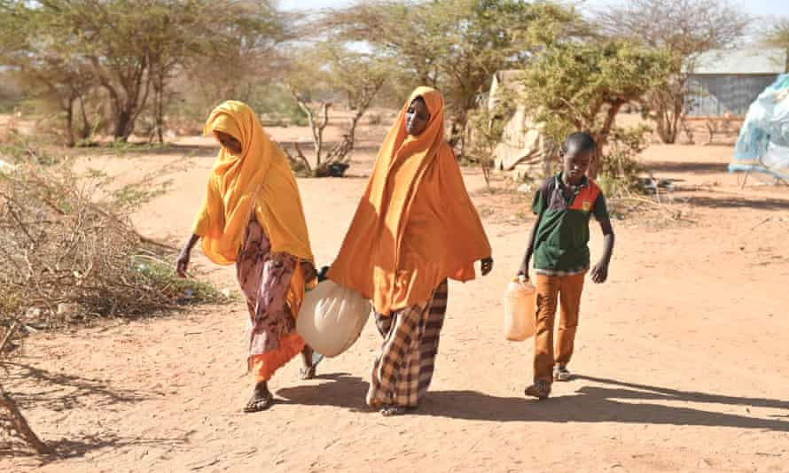 People return after fetching water to the internal displaced person camp in Somalia at Doolow, a border town with Ethiopia