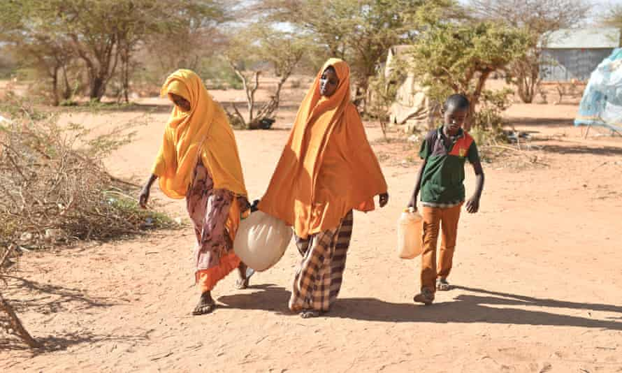 Somalians fleeing drought fetch water at a camp in Doolow as humanitarian agencies warn that famine could affect 6.2 million peopl.