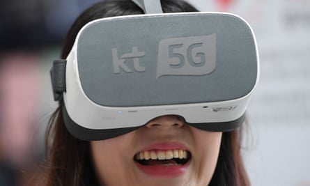 An employee demonstrates 5G services on a VR device for South Korean telecom operator KT.
