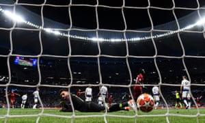 Sadio Mane of Liverpool celebrates his team's second goal as Hugo Lloris of Tottenham Hotspur looks on