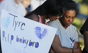 Members of Tyre King's family console each other during a vigil for the 13-year-old last week in Columbus, Ohio.