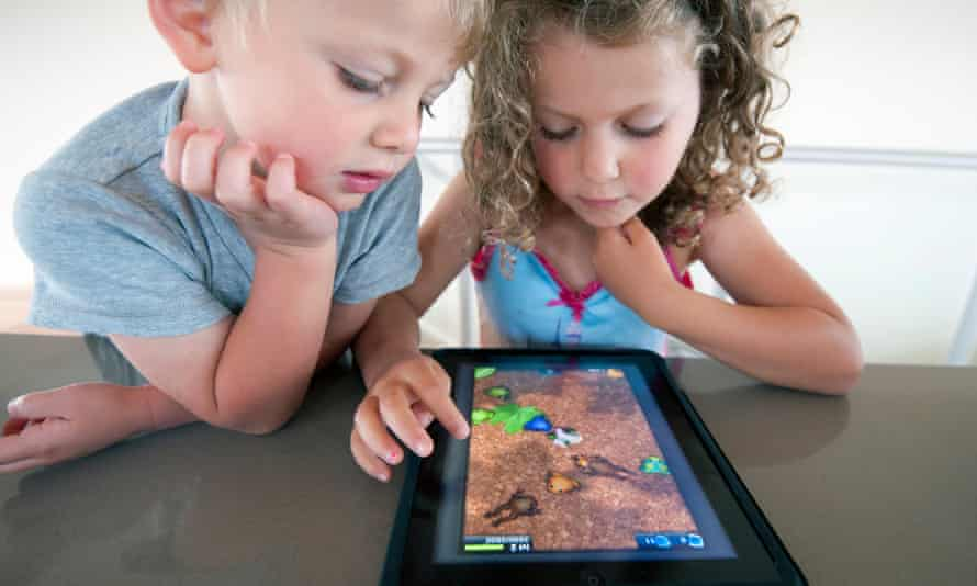 Children playing computer game on a  tablet computer