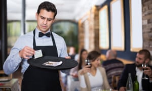 Tip for tat … a waiter (posed by a model) examines a handwritten note.