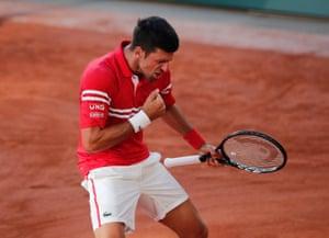 Novak Djokovic celebrates winning his 19th Grand Slam.