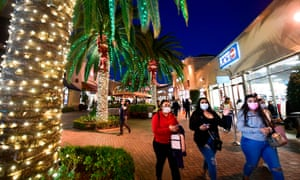 Shoppers wear masks at the Citadel Outlets in Los Angeles, California.