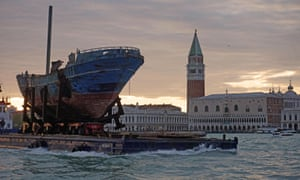 The boat is transported through the Venetian lagoon