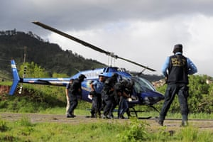 Tegucigalpa, Honduras: Police escort Carlos Miguel Cordon, whom the United States has requested in extradition for drug trafficking, from a helicopter after his capture