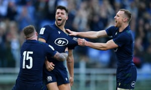 Adam Hastings celebrates after scoring Scotland's third try.