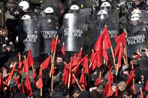 Athens, Greece: Striking students and contract teachers face a police blockade in front of the Greek parliament during a rally to call for the withdrawal of legislation changing how educators are appointed in the public school system