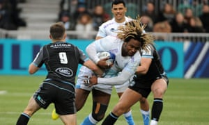 Sale's Marland Yarde tries to break tackles against Glasgow.
