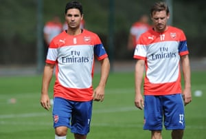 Mikel Arteta and Nacho Monreal during an Arsenal training session in 2014
