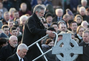 Gerry Adams steps up to speak at Derry city cemetery after the funeral service.