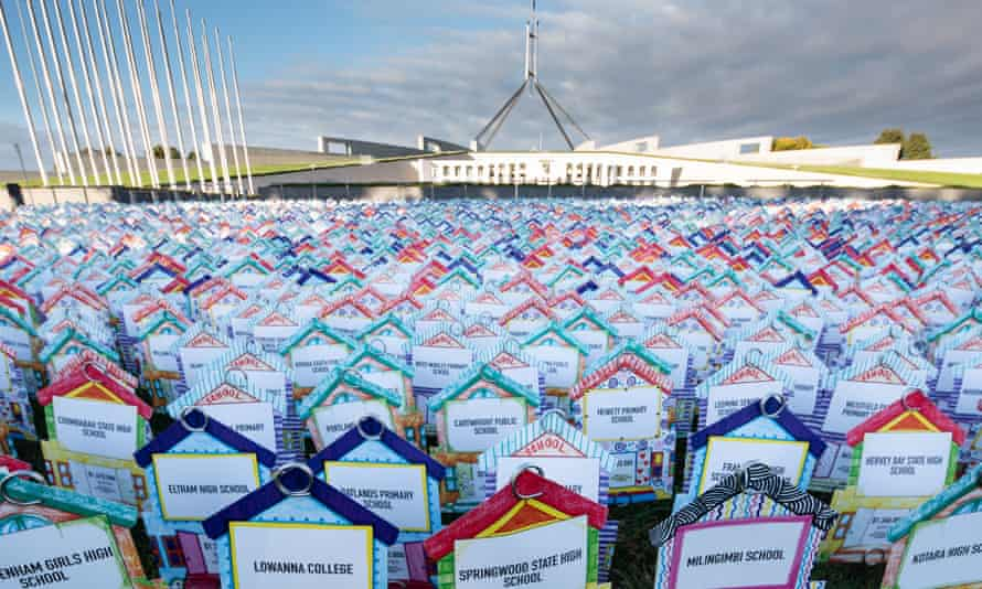 Signs with names of schools with Parliament House in the background. AEU Canberra