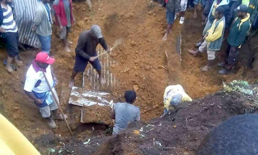 Rescuers dig for bodies in Mendi after the 26 February earthquake.