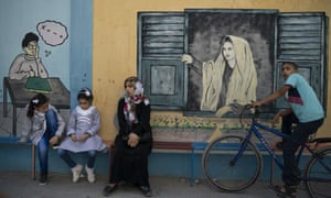 Two Palestinian girls sit outside a UNRWA school before their first day of class in Gaza City on Wednesday.