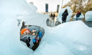 The big thaw … a visitor inspect Ice Watch London, Sam Hodge, which has arrived outside Tate Modern.