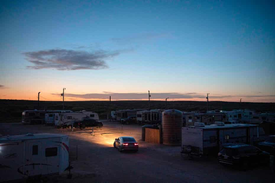 An RV park that is both a temporary and long-term home for many oil field workers is seen at dusk in Carlsbad, New Mexico.