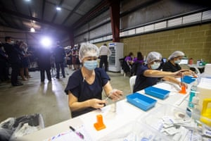 Nurses draw up doses from a multi-dose vile of AstraZeneca Covid-19 vaccine at Claremont Showgrounds in Perth last week. The West Australian Government have opened up two new vaccine centres, including one at Perth Airport.