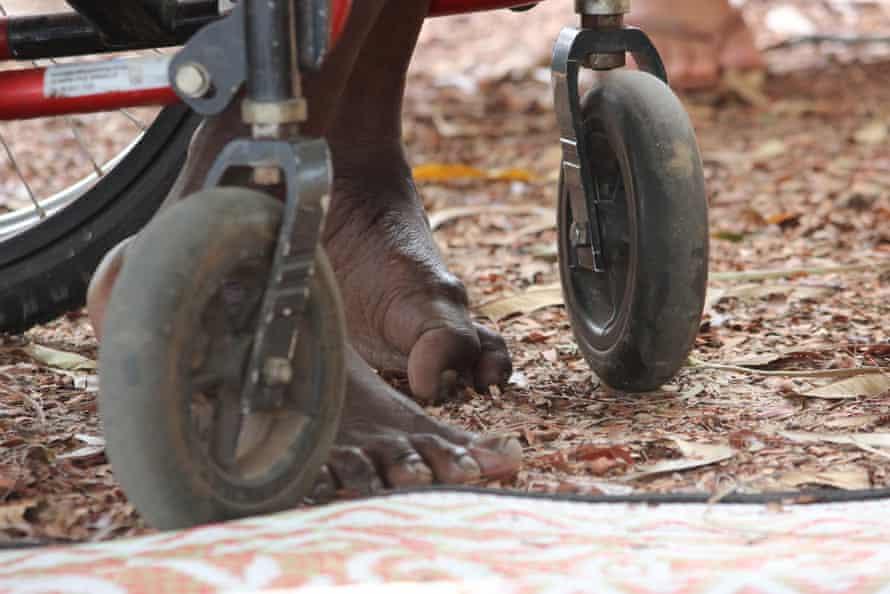 Rex Munungurr's wheelchair isn't suitable for the uneven ground.