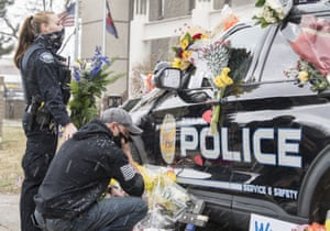 Colorado, US. Fellow officers leave flowers and messages on a police vehicle driven by slain officer Eric Talley, who was among 10 people killed by a gunman at a grocery store in Boulder