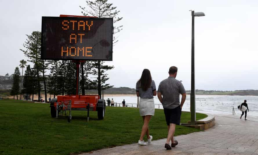 Public health messaging is displayed on temporary signage at Dee Why on Sydney's northern beaches after an outbreak of Covid was detected in the area.