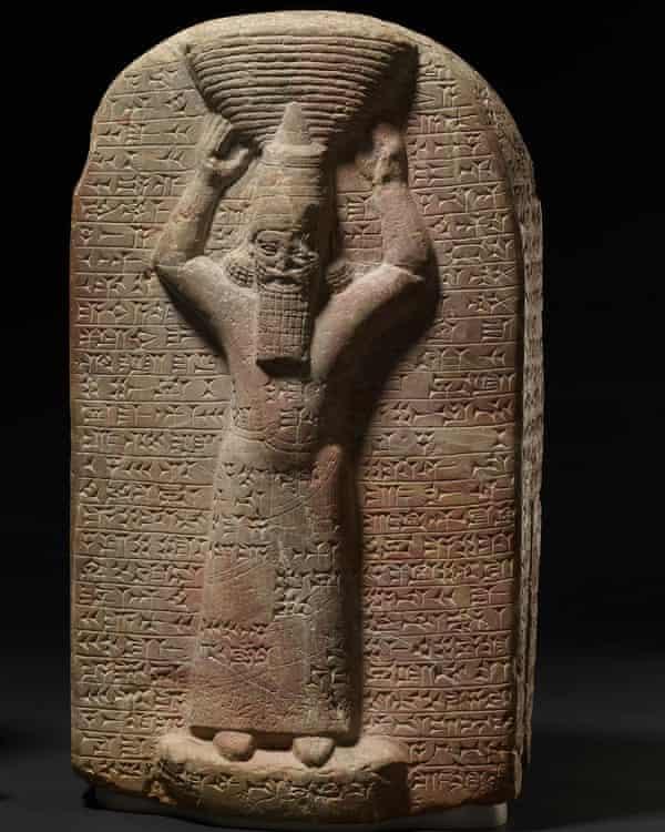 Ashurbanipal, shown with cuneiform inscription.