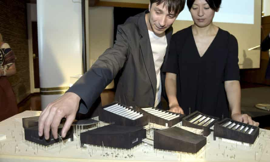 Nicolas Moreau (L) and Hiroko Kusunoki with a model of their winning design, Art in the City.