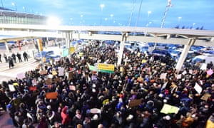Thousands gathered at Terminal Four at JFK Airport to protest against the detention of several travellers under Trump's first travel ban on 28 January.