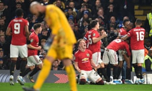 Manchester United's Marcus Rashford celebrates with teammates after he takes a free-kick and scores his team's second goal.