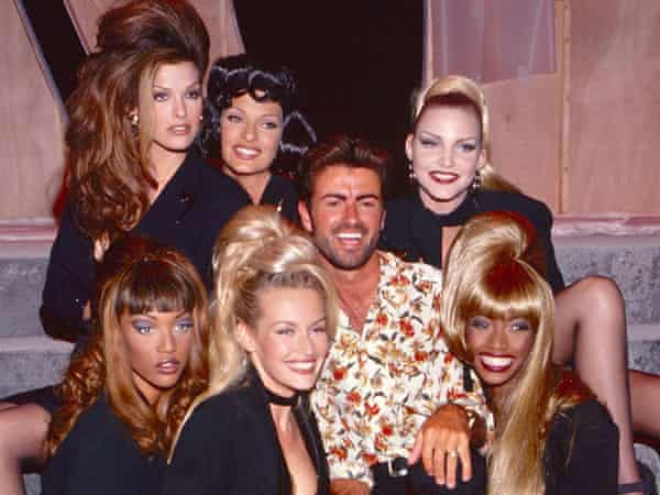 """Tyra Banks, Linda Evangelista, George Michael and Eva Herzigova, Beverly Peele pose during the """"Too Funky"""" video shoot circa 1992 in Paris, France. (Photo by Kevin Mazur/Getty Images)"""