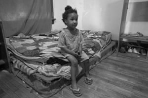 A child in a substandard home that her family had to accept after being evicted from their previous home in Milwaukee.