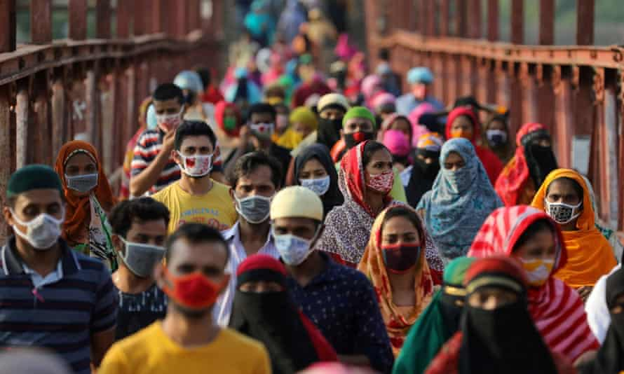 Garment workers return from a workplace in Dhaka, Bangladesh, May 4, 2020.