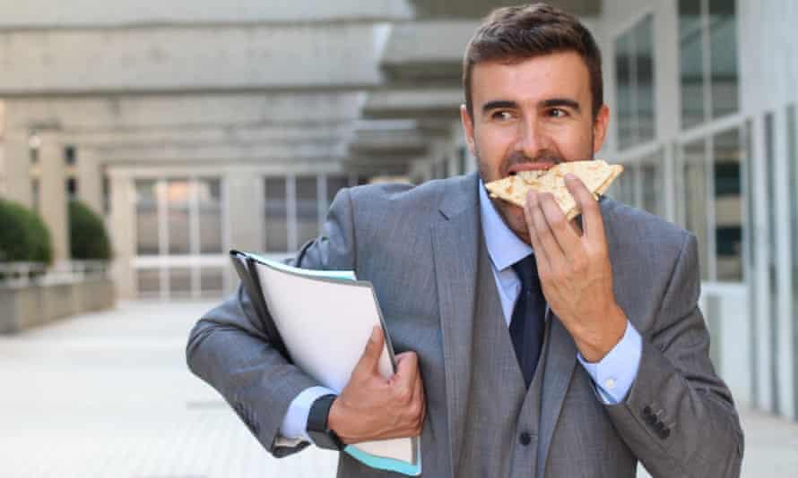 A businessman eating on the go