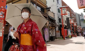 A woman wearing a face mask at Senso-ji Temple in Asakusa district, Tokyo, on Wednesday.
