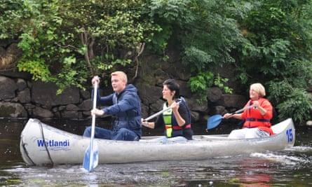 Three people canoeing, Scandinavia