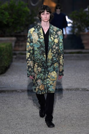 A model walks in a tapestry coat the runway at the Givenchy fashion show in June in Florence.