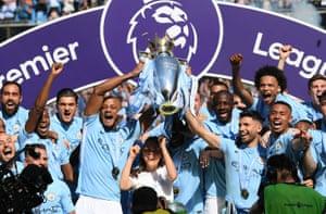 Manchester City lift the Premier League Trophy.