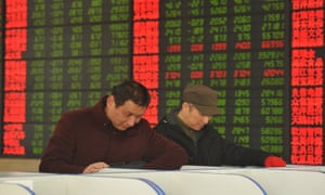 Concerned Chinese investors look at prices of shares