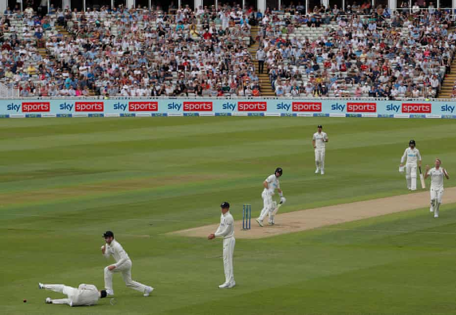 Olly Stone (right) reacts after Joe Root (left) dropped Will Young.
