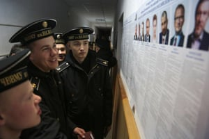 Cadets of the Nakhimov naval academy vote at a polling station during Russia's presidential election in Sevastopol, Crimea, on March 18, 2018. / AFP PHOTO / STRSTR/AFP/Getty Images