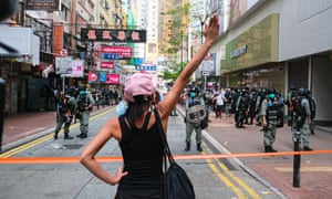 A protester confronts police during a protest in Hong Kong on 1 July as new security laws were introduced.