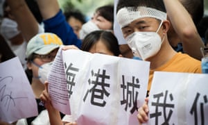 An injured Tianjin resident takes part in protests outside the Mayfair hotel on Monday.