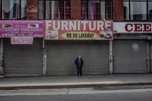 A lone person along the streets in the Bronx, New York on 30 March 2020. Photo By Jordan Gale