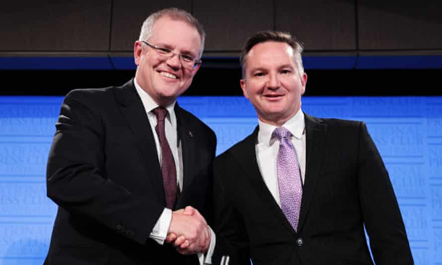 Scott Morrison and Chris Bowen shake hands after the treasurers' debate at the National Press Club on Friday.