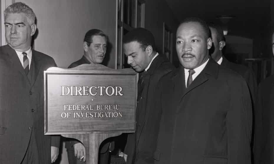 Martin Luther King arriving at the FBI office to speak with its director, J Edgar Hoover