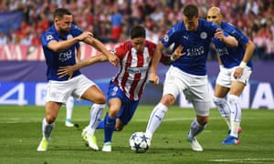 Leicester's Danny Drinkwater, left, and Robert Huth combine to thwart Atlético's Fernando Torres.