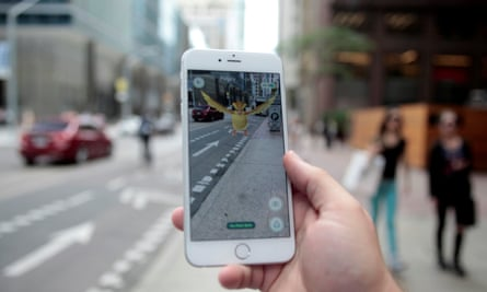 A 'Pidgey' Pokémon is seen on the screen of the Pokémon Go mobile app as a hunter plays in downtown Toronto.