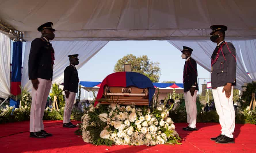 Police officers guard the coffin at the beginning of the ceremony.